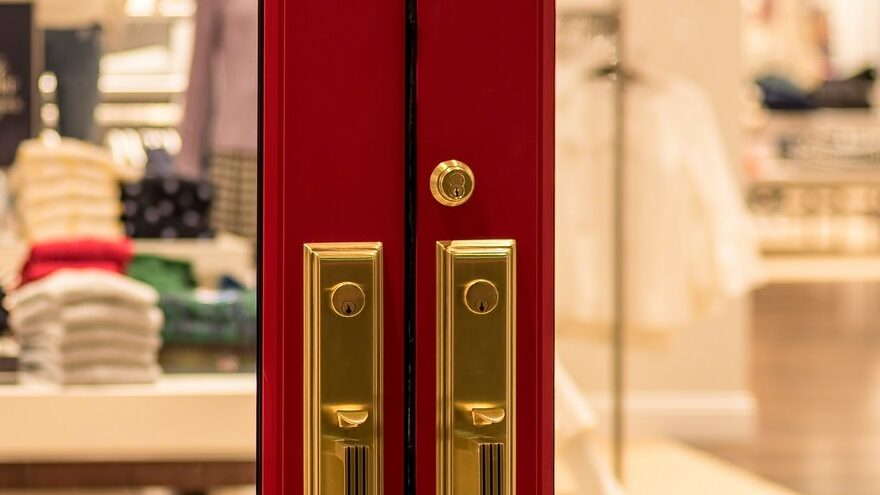 Big red doors looking into a retail store